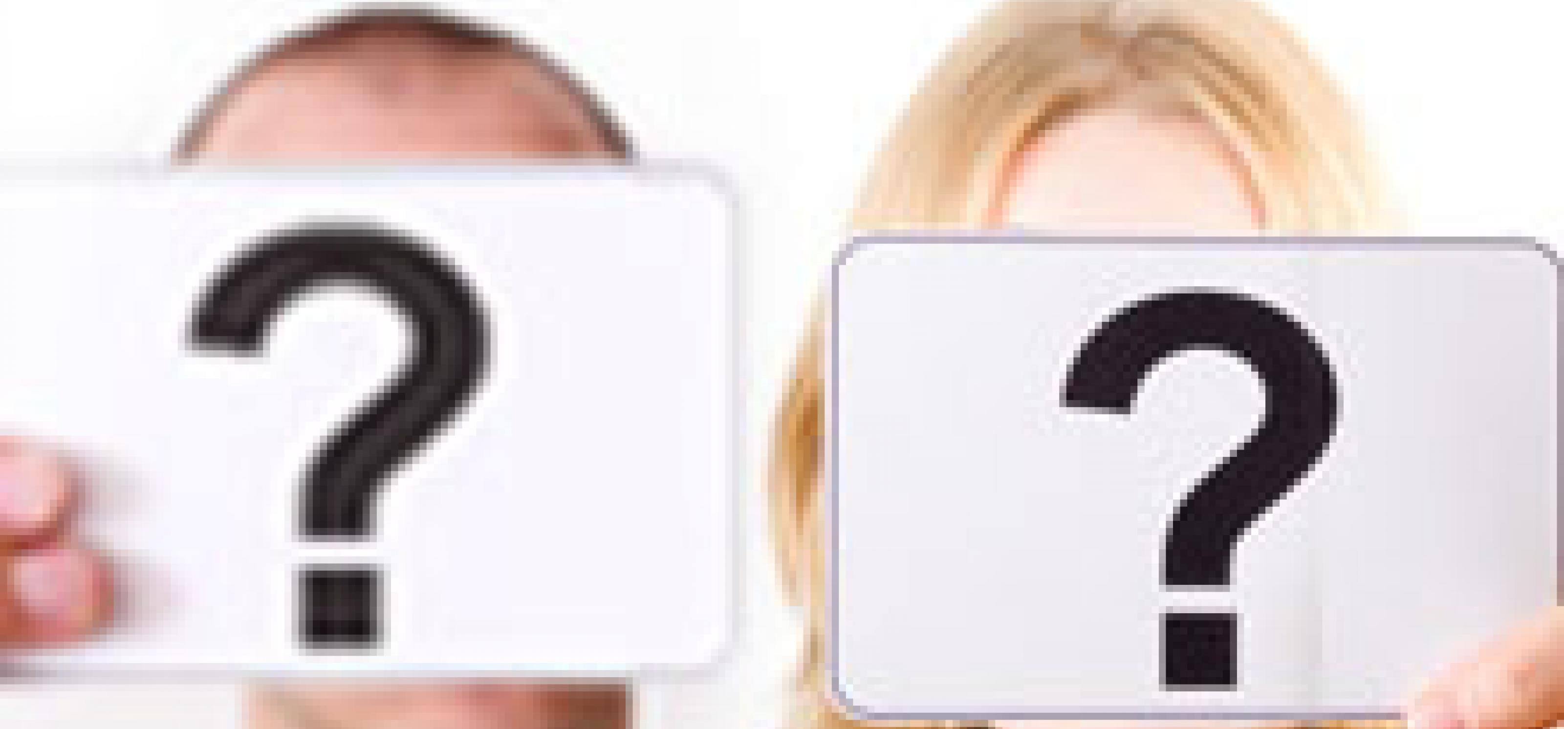 man and woman holding question marks in front of their faces